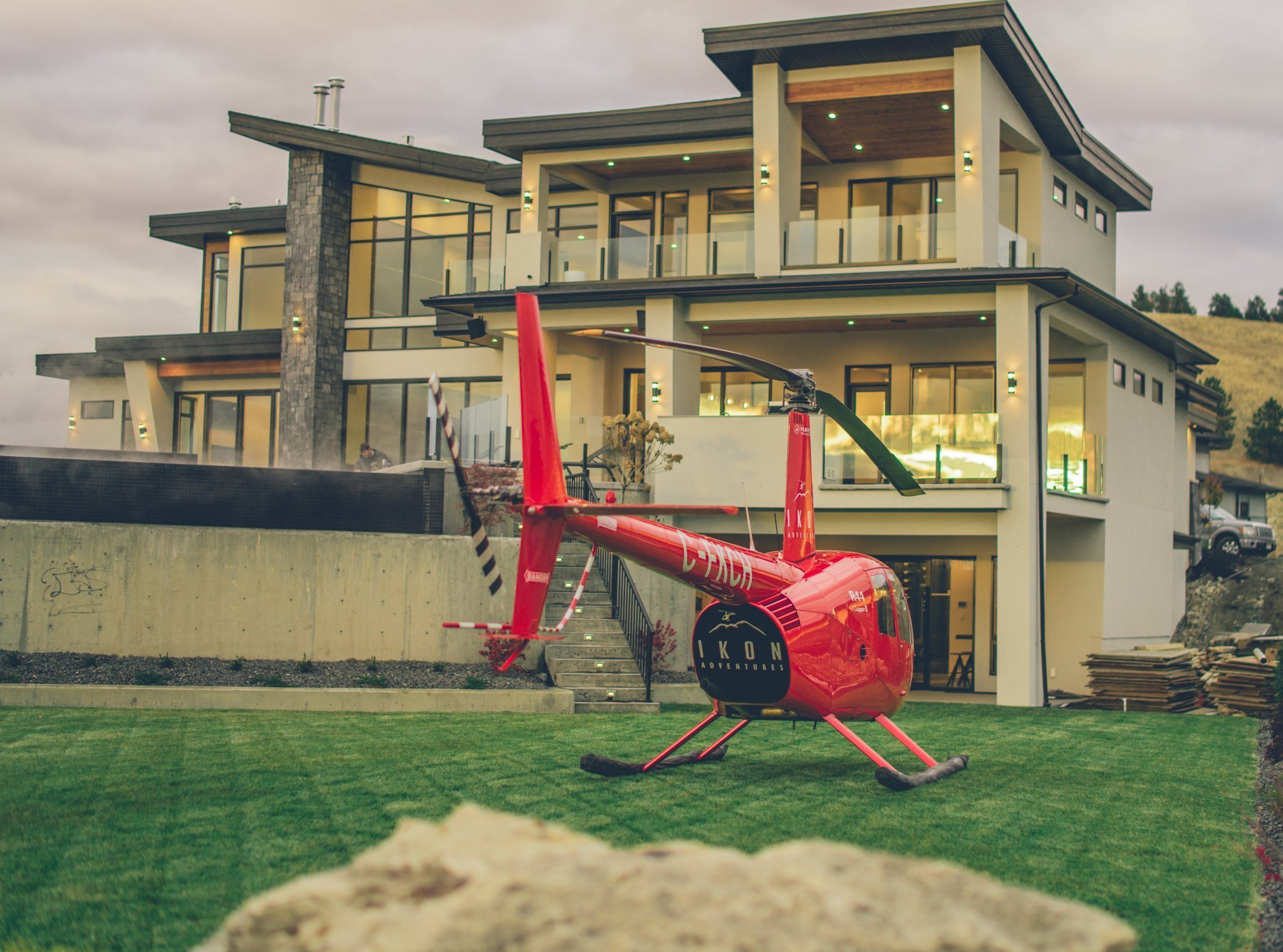 Hiilite | Marketing, SEO, Branding, Web & Graphic Design A helicopter from a local successful business parked in-front of one of the luxury homes in Kelowna, BC