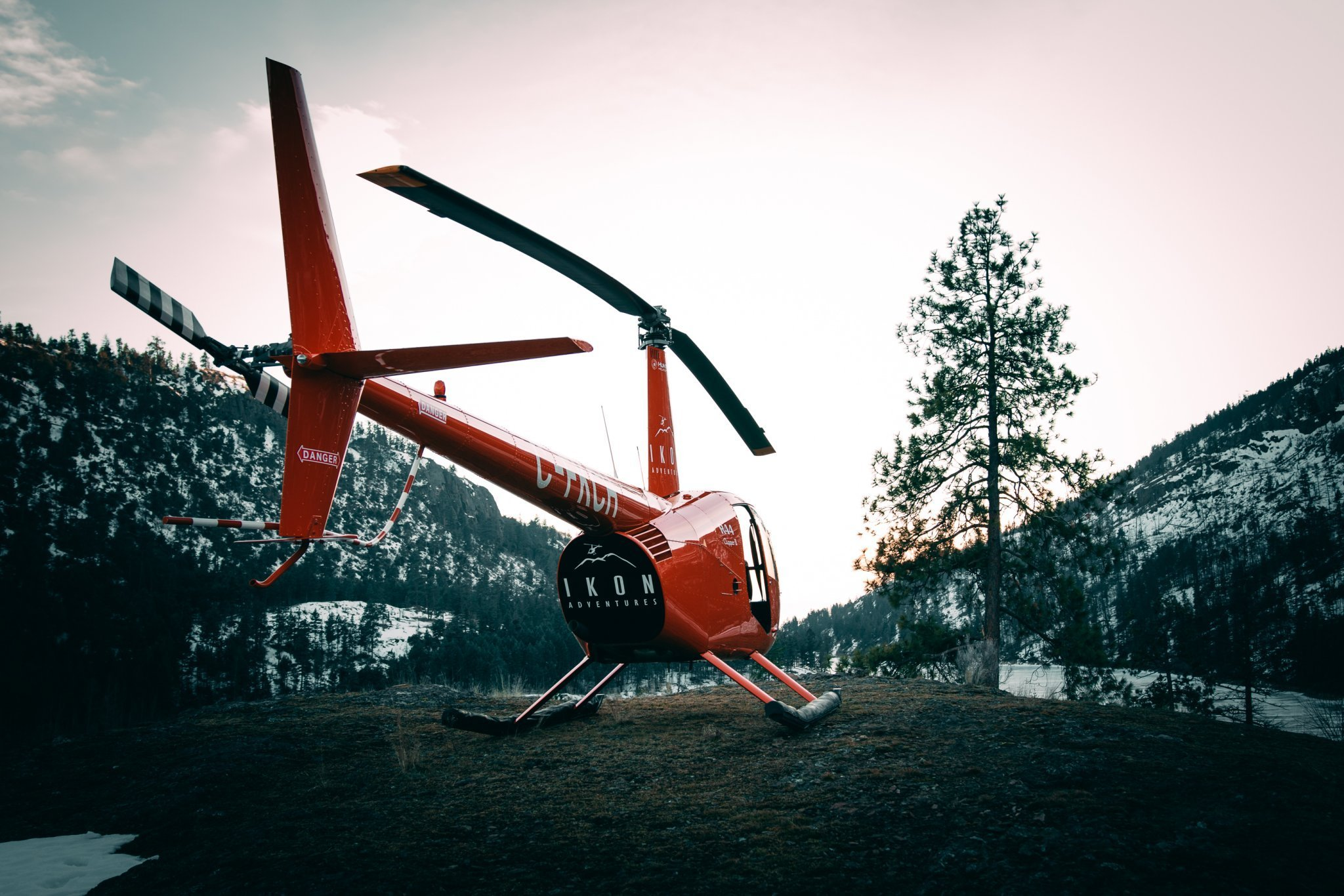 Hiilite | Marketing, SEO, Branding, Web & Graphic Design The helicopter of Ikon Adventures in Kelowna perched on a mountain near Kelowna, British Columbia