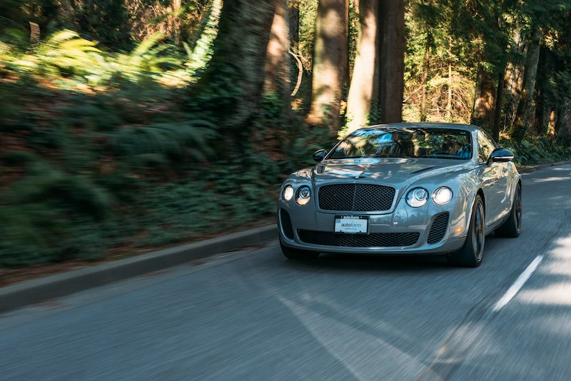 A Bentley super car driving down the road in Vancouver, captured with a Sony mirrorless camera