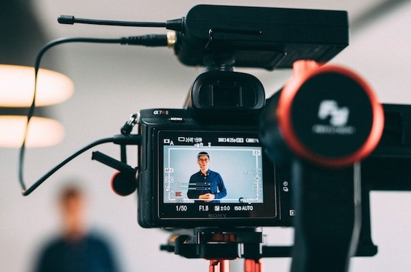 A young professional creative man recording a video for his personal brand