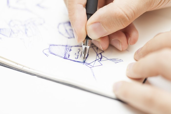 web design marketing seo | A male designer sketching a creative solution to a problem in his workplace