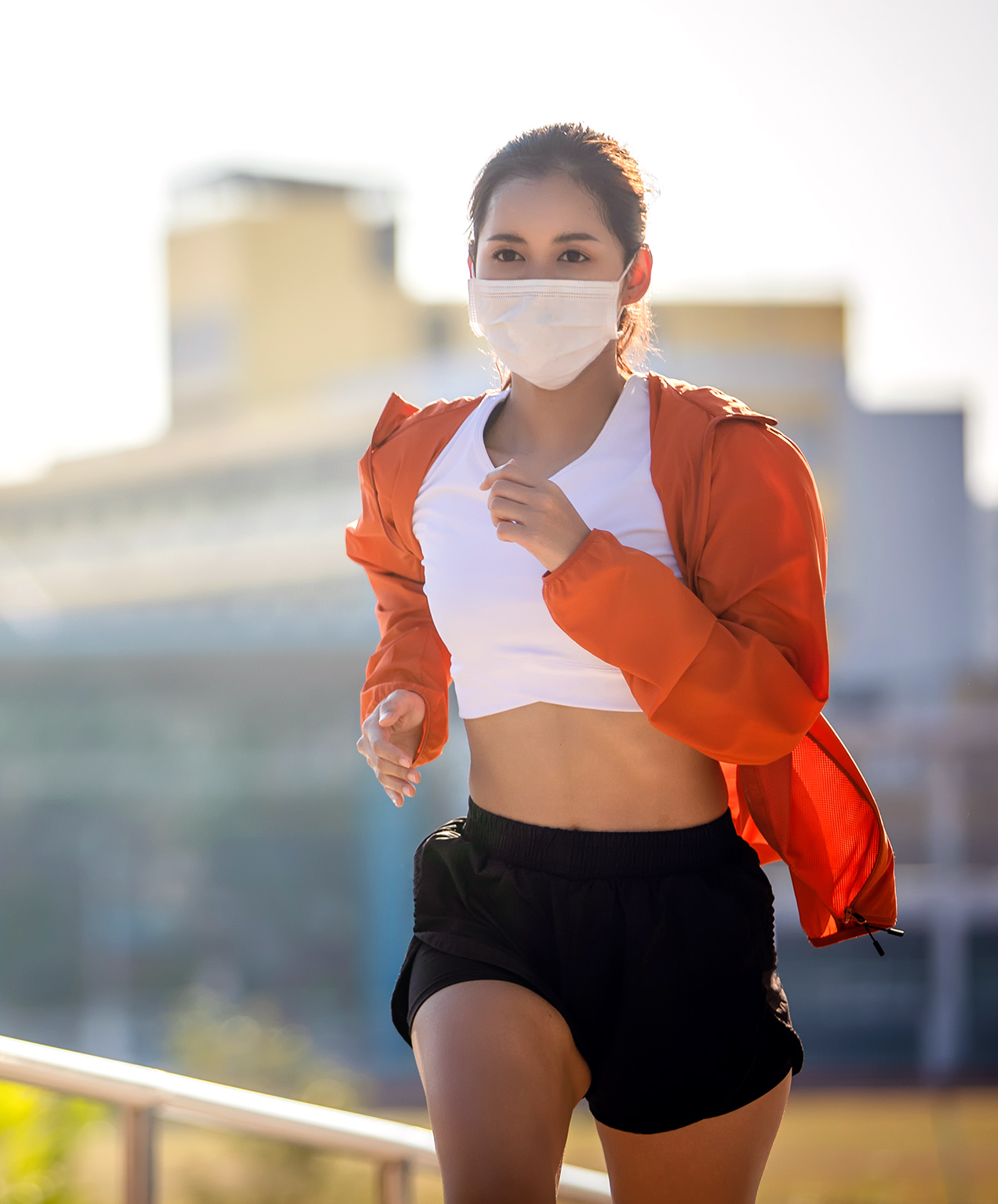 healthcare organization marketing woman jogging with mask