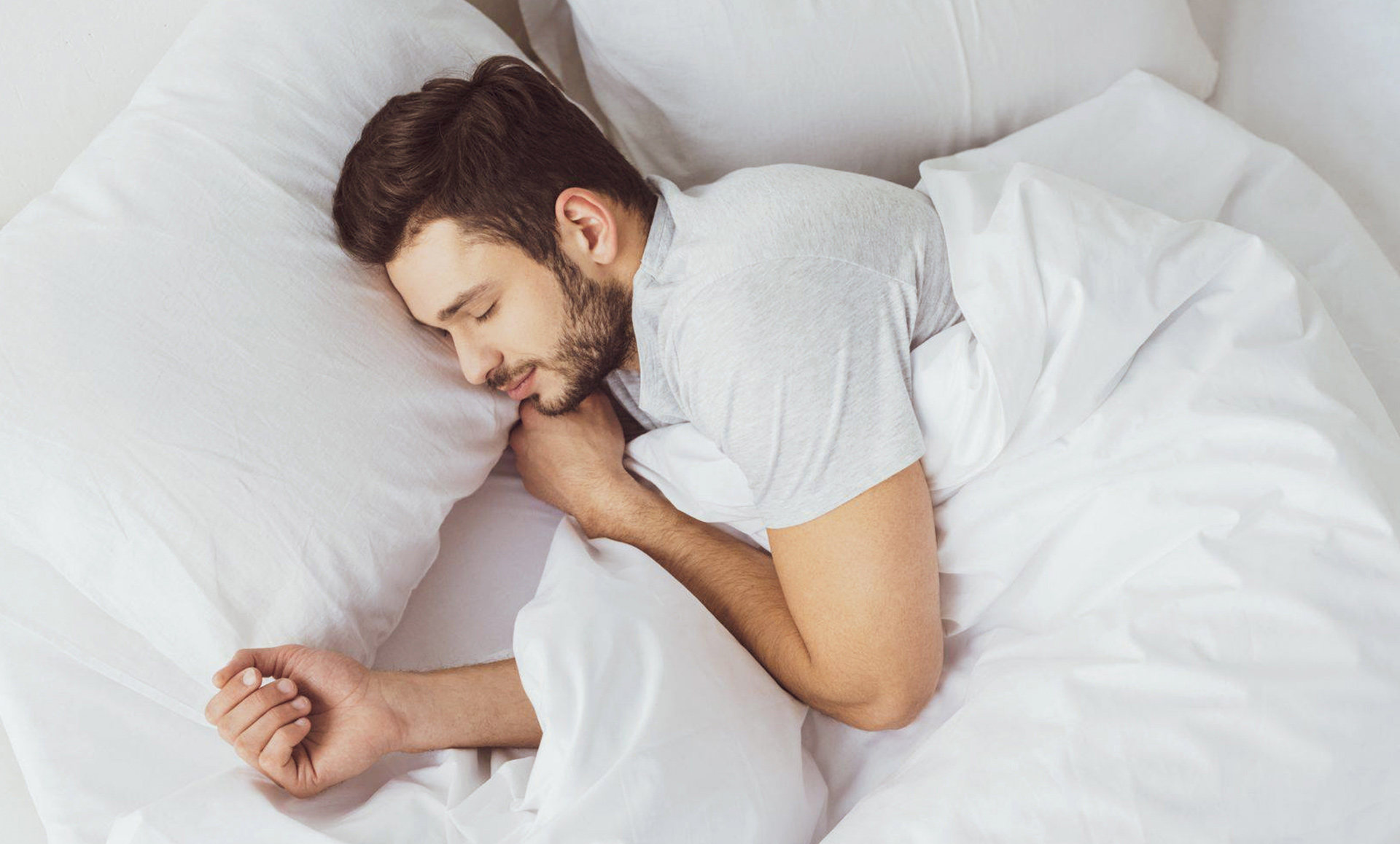 retail marketing for furniture company man sleeping in bed