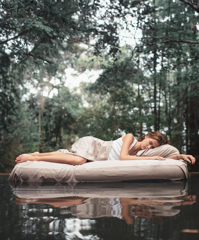 retail marketing woman on mattress