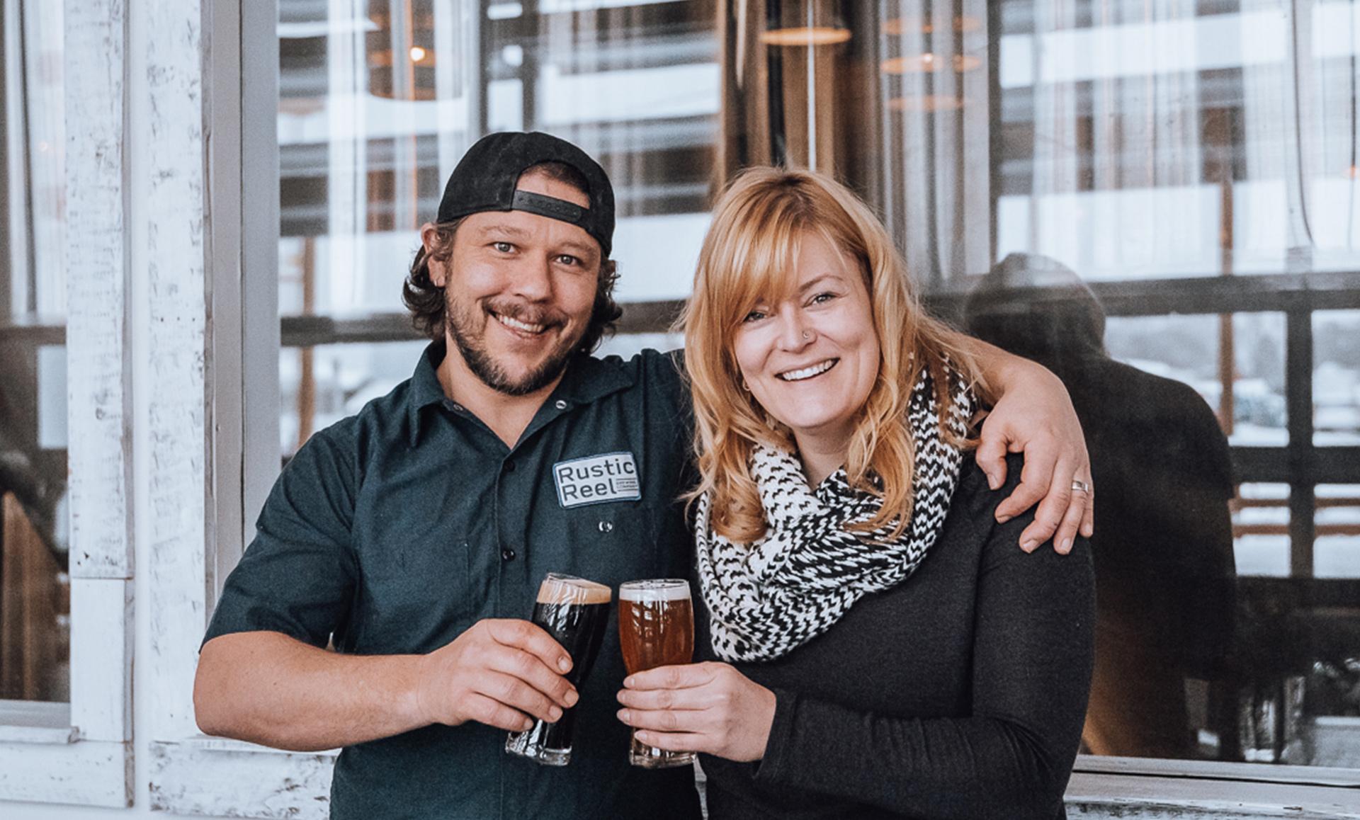 kelowna brewery marketing owner and staff cheers