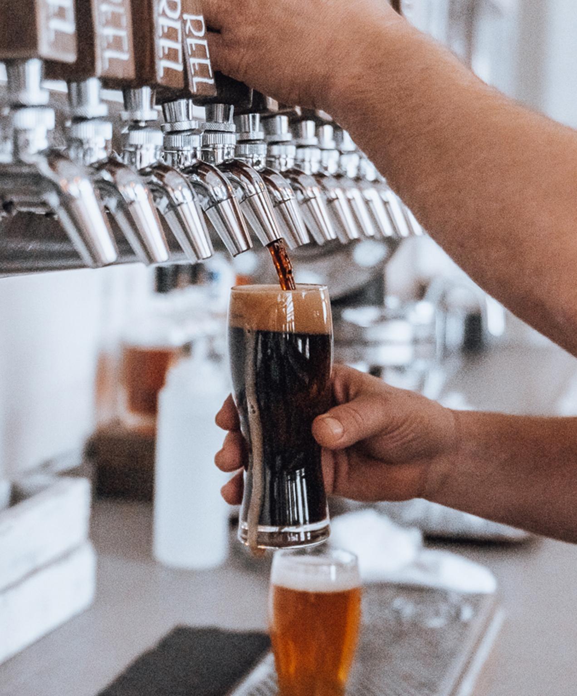kelowna brewery marketing beer being oured