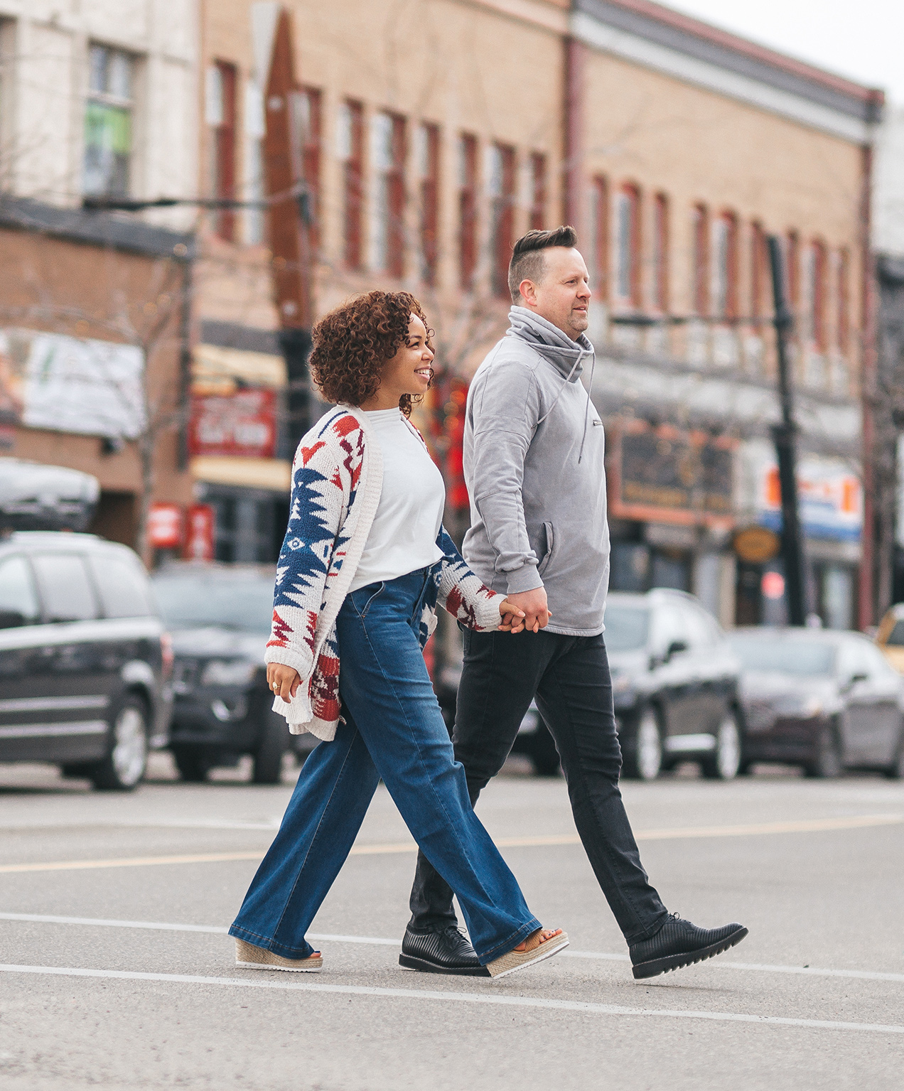 retail shoe store marketing couple walking downtown in new shoes
