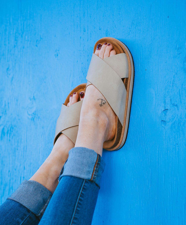 shoe store marketing wood shoes on blue background