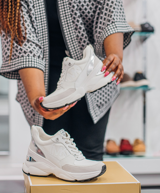 retail shoe store marketing white mk shoes