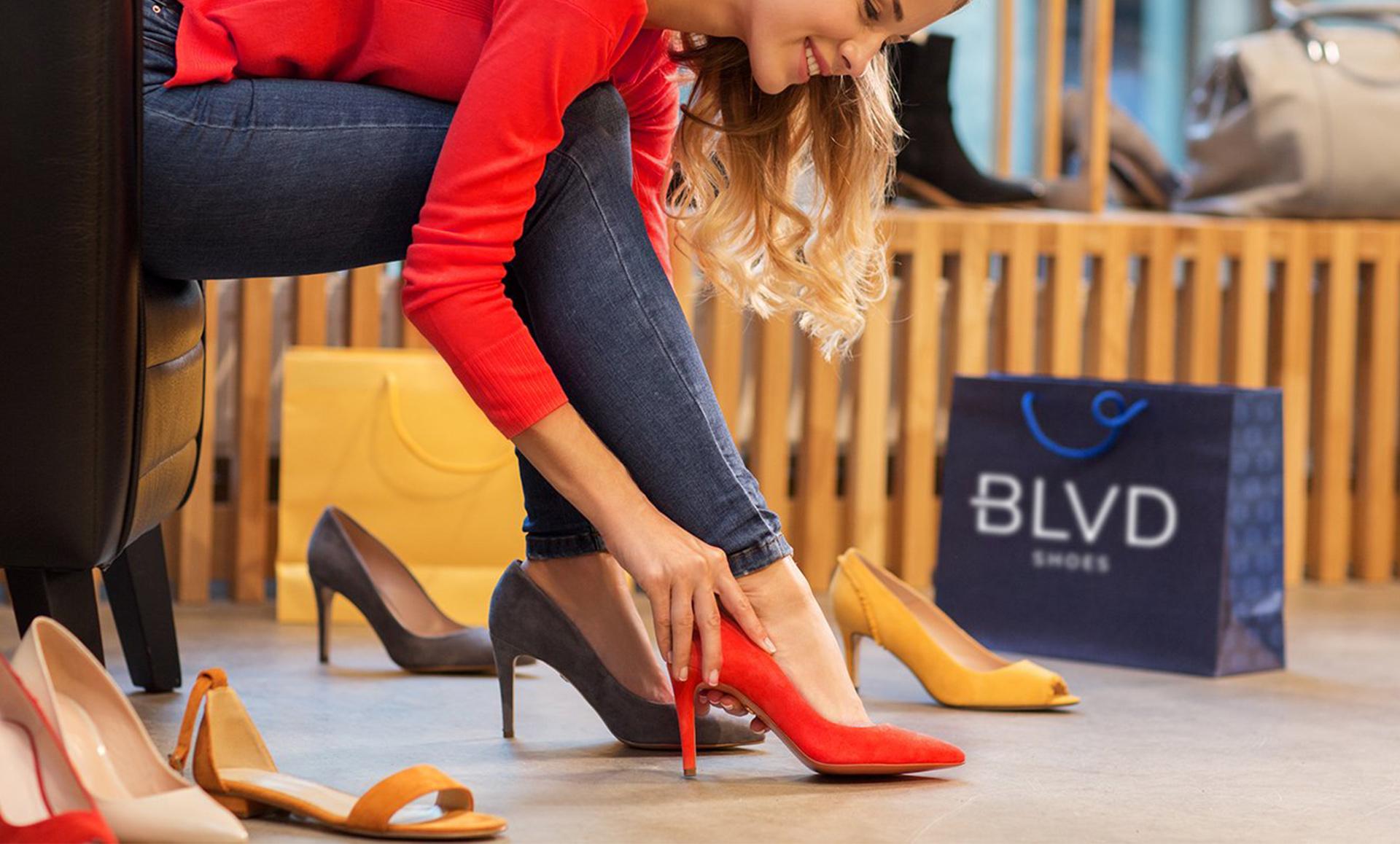shoe store marketing women trying on shoes